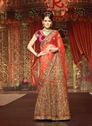 awesome heavy embroidered magenta and red designer bridal lehenga