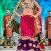 Enchanting magenta and purple color net fabric lehenga