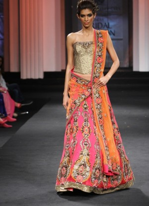 7aaa201fca Gleaming fully embroidered designer lehenga with golden choli and contrast  orange dupatta