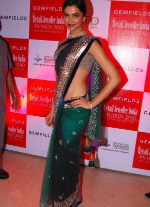 stimulating green and blue bollywood saree design with silver handwork on net fabric
