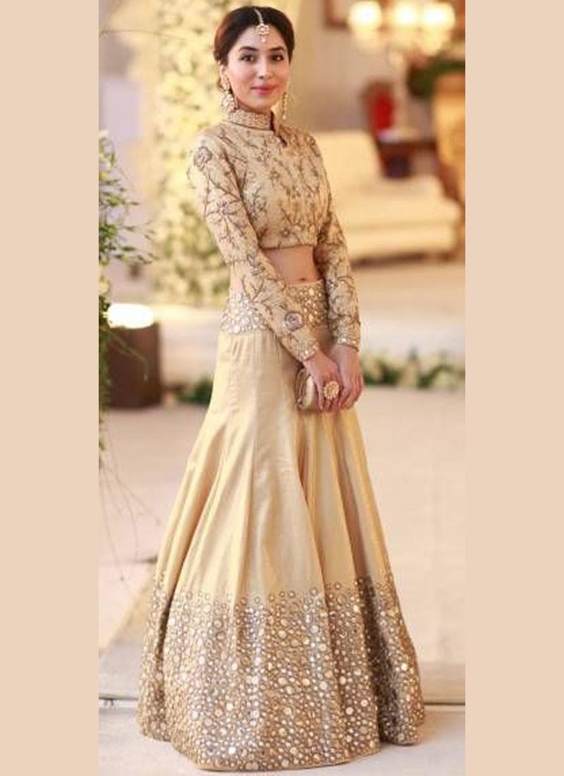 Lehenga blouse design in golden color and mirror work - Beige Color Raw Silk Wedding Sangeet Lehenga Choli With Mirror Work At Zikimo