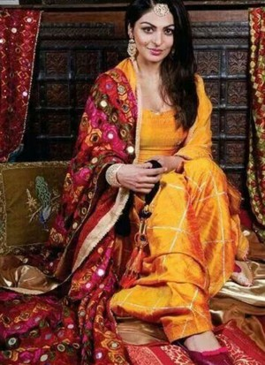Neeru Bajwa Mango Yellow color Raw Silk Punjabi Salwar Kameez With Phulkari Dupatta at Zikimo