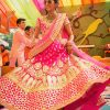 Enthralling Fuchsia Indian Bridal Lehenga Choli with Gota Patti Work At Zikimo